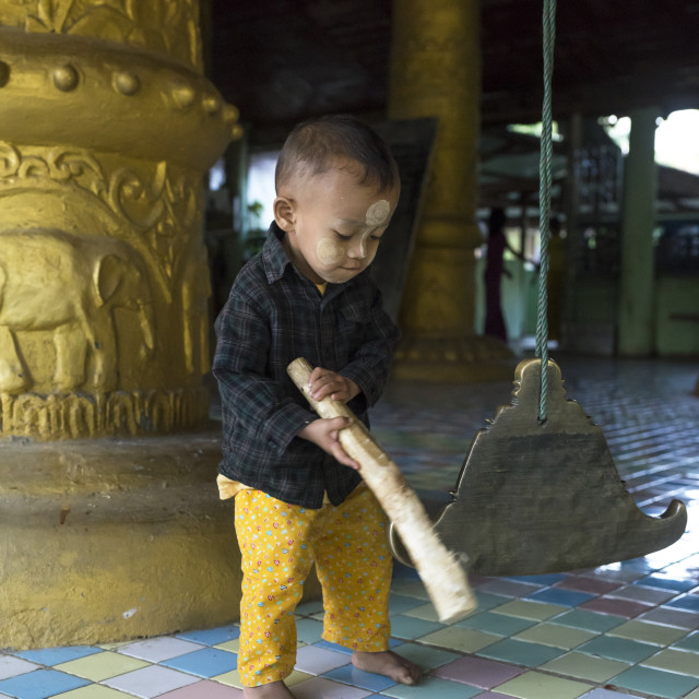 """""""Litlle Boy Ringing A Bell In A Temple, Mrauk U, Myanmar"""" stock image"""