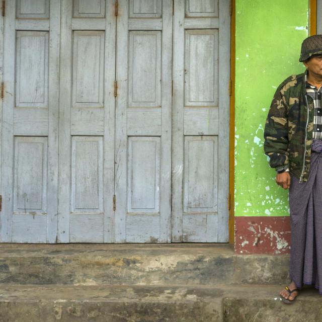 """Man In Army Uniform Standing In The Street, Sittwe, Myanmar"" stock image"