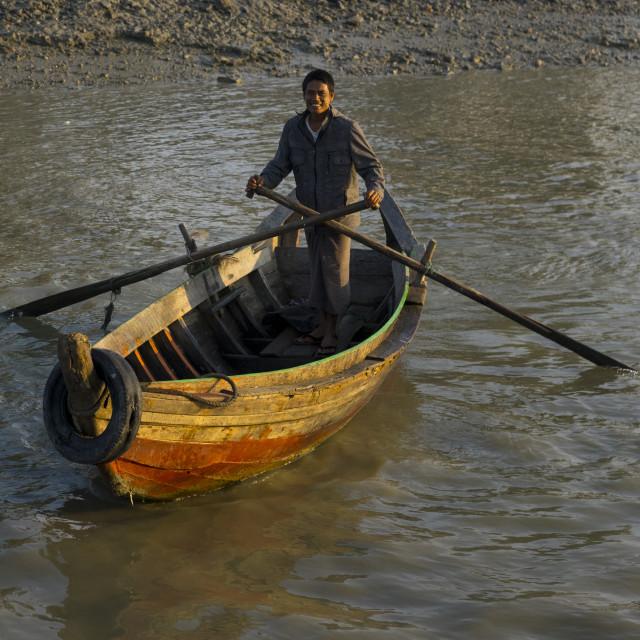 """Man Rowing In The Port, Sittwe, Myanmar"" stock image"