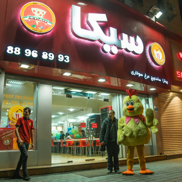 """""""chicken mascot in front of sika pizza restaurant, Central district, Tehran, Iran"""" stock image"""