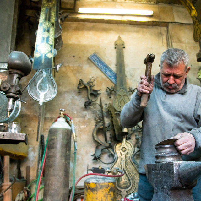 """""""master safar fooladgar creating an alam in his workshop, Central district,..."""" stock image"""