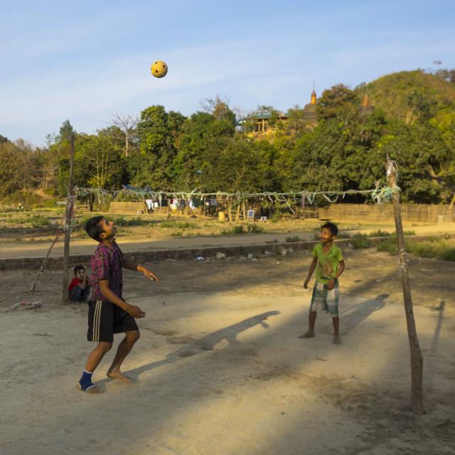 """""""Children Playing Chinlone On Street, Mrauk U, Myanmar"""" stock image"""