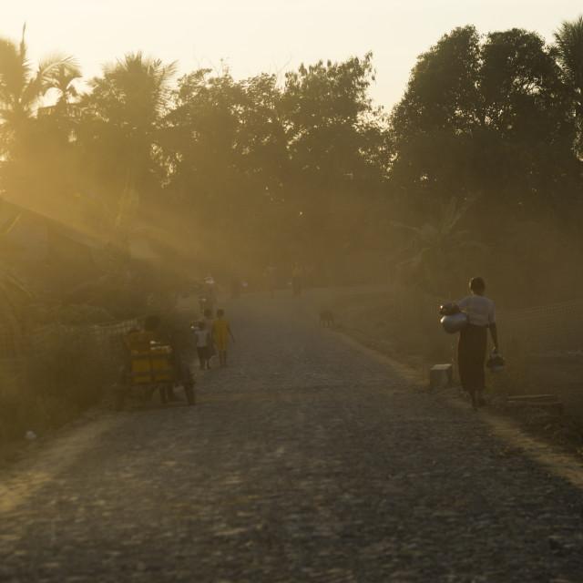 """Dusty Road In The Sunset, Mrauk U, Myanmar"" stock image"