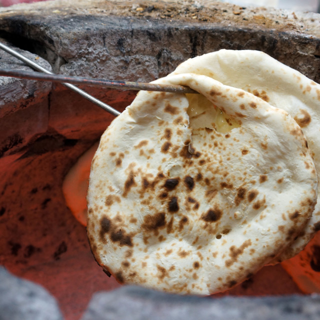 """Preparing cheese naan. A traditional Indian food"" stock image"