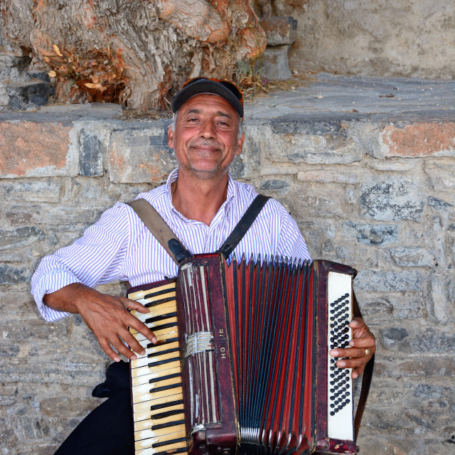 """Piano accordion player in Agios Nikolaos, Crete"" stock image"