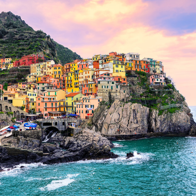 """Colorful houses on a rock in Manarola, Cinque Terre, Italy"" stock image"