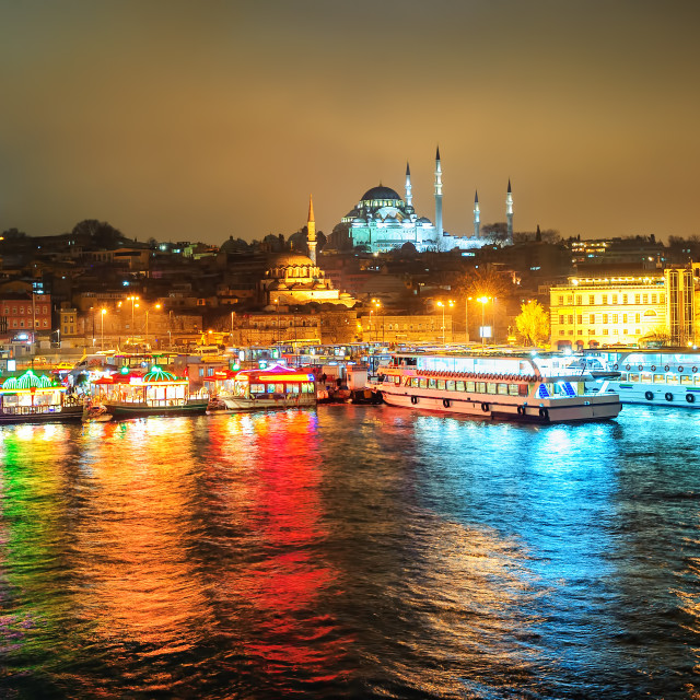 """Fish boat restaurants on Golden Horn at night, Istanbul, Turkey"" stock image"