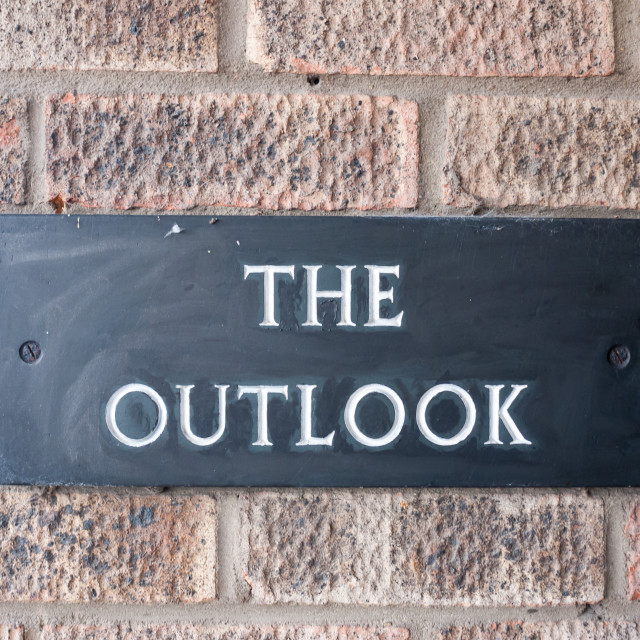 """""""close up of black house sign the outlook on brick wall"""" stock image"""