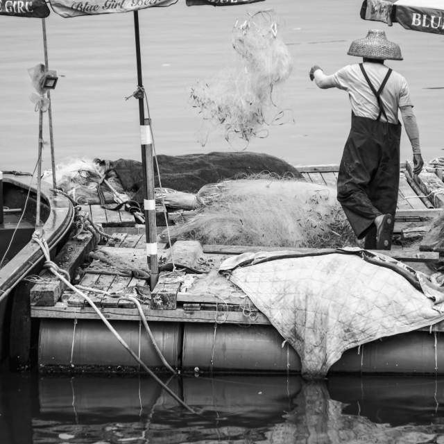 """A Man throwing a fishing net"" stock image"