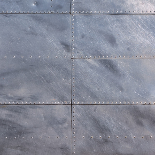 """""""Airplane fuselage silver metal texture with rivets."""" stock image"""