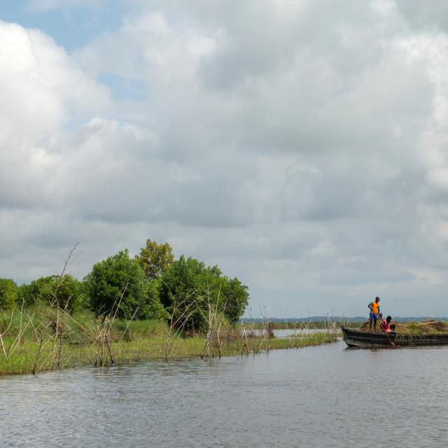"""Benin, West Africa, Ganvié, boat on lake nokoue"" stock image"