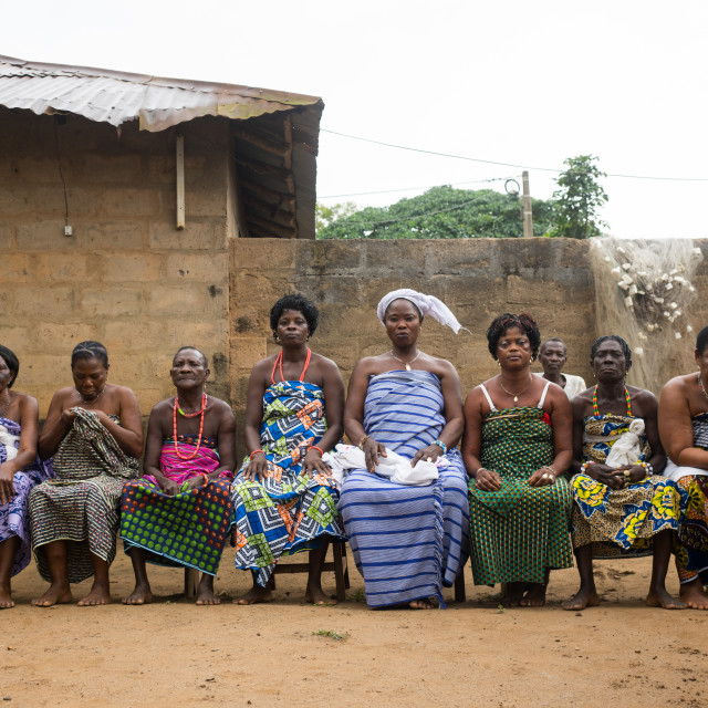 """""""Benin, West Africa, Bopa, women sitting on bench in line during a voodoo..."""" stock image"""