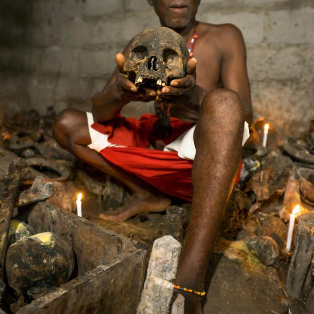 """""""Benin, West Africa, Bopa, dah tofa voodoo master showing the skulls criminals..."""" stock image"""
