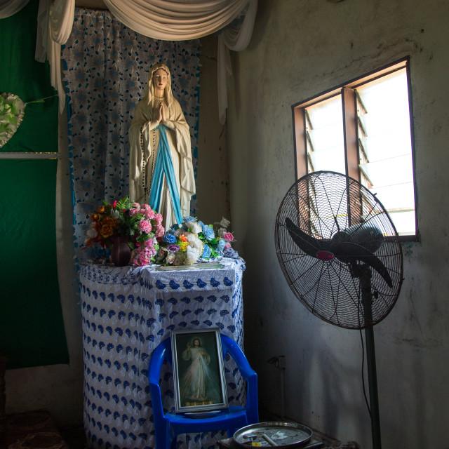 """Benin, West Africa, Ganvié, virgin maria statue inside a house on lake nokoue"" stock image"