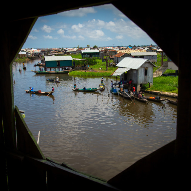 """Benin, West Africa, Ganvié, boats queueing to collect fresh water on lake nokoue"" stock image"