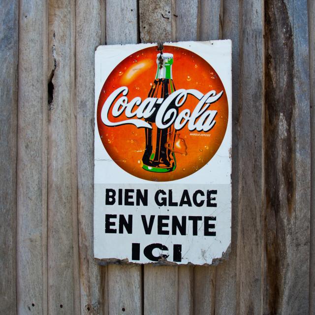 """""""Benin, West Africa, Ganvié, a coca cola sign adverstising on a wooden door"""" stock image"""