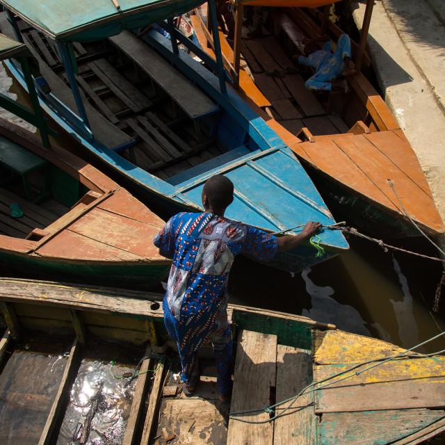 """Benin, West Africa, Ganvié, boats parked on lake nokoue"" stock image"