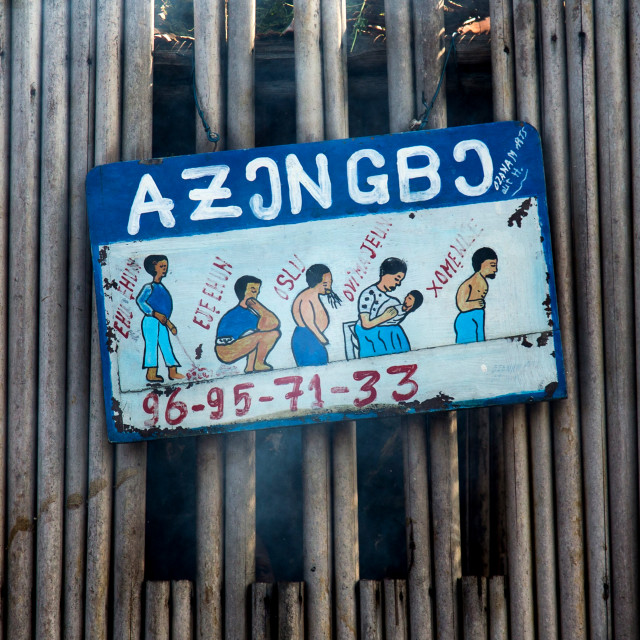 """Benin, West Africa, Ganvié, roadside sign for traditional witchcraft"" stock image"