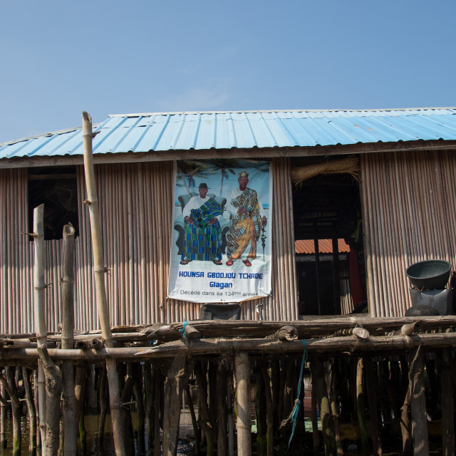 """Benin, West Africa, Ganvié, death annoucement on the wall of a stilt house on..."" stock image"