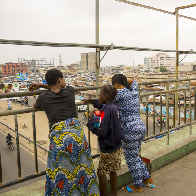 """Benin, West Africa, Cotonou, people on the bridge over dantokpa market"" stock image"
