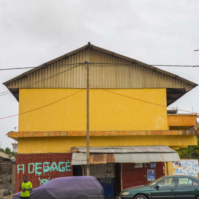 """Benin, West Africa, Cotonou, house tagged to be destroyed by the governement..."" stock image"