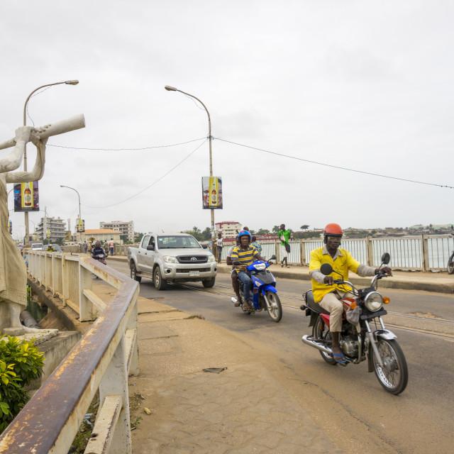 """Benin, West Africa, Cotonou, motos and cars passing on the bridge over nokoue..."" stock image"