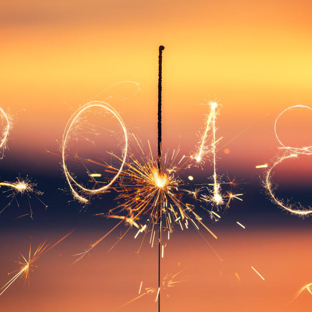 """""""2018 written with Sparkle firework on sunset background, happy n"""" stock image"""