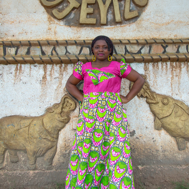 """""""Benin, West Africa, Savalou, woman pausing in front of a king palace"""" stock image"""