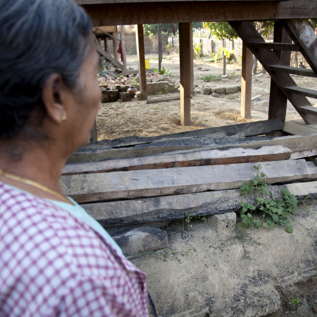 """""""Rohingya Woman Showing The Pillar Of Her House Burnt By 969 Extremists..."""" stock image"""