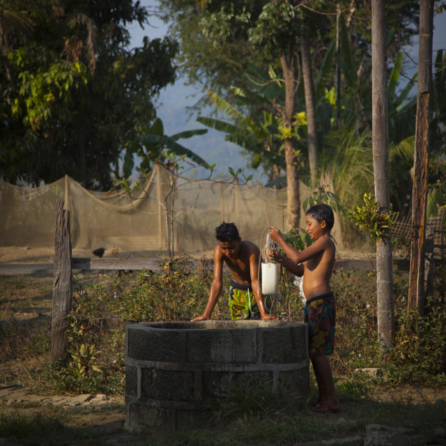 """""""Rohingya Children In Front Of The Village Well, Thandwe, Myanmar"""" stock image"""