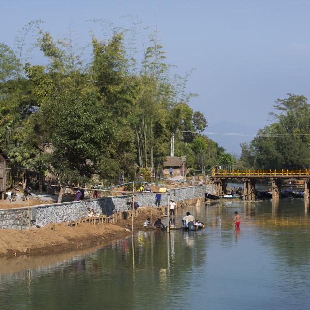 """People Wasing Clothes, Inle Lake, Myanmar"" stock image"
