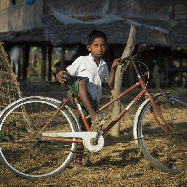 """""""Rohingya Boy With His Bike, Thandwe, Myanmar"""" stock image"""