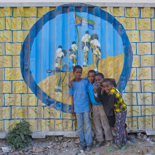 """Kids Standing In Front Of A Propaganda Painting, Keren, Eritrea"" stock image"