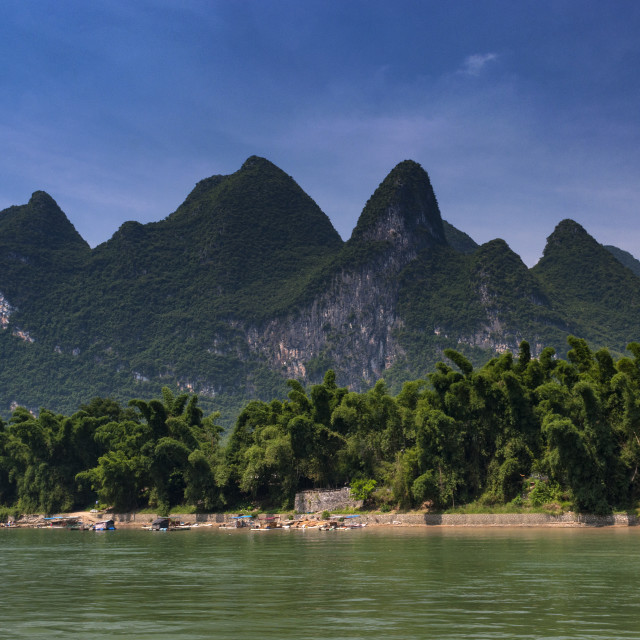"""View of the Li River with the tall limestone peaks on the background near Yangshuo, China, Asia; Concept for travel in China"" stock image"