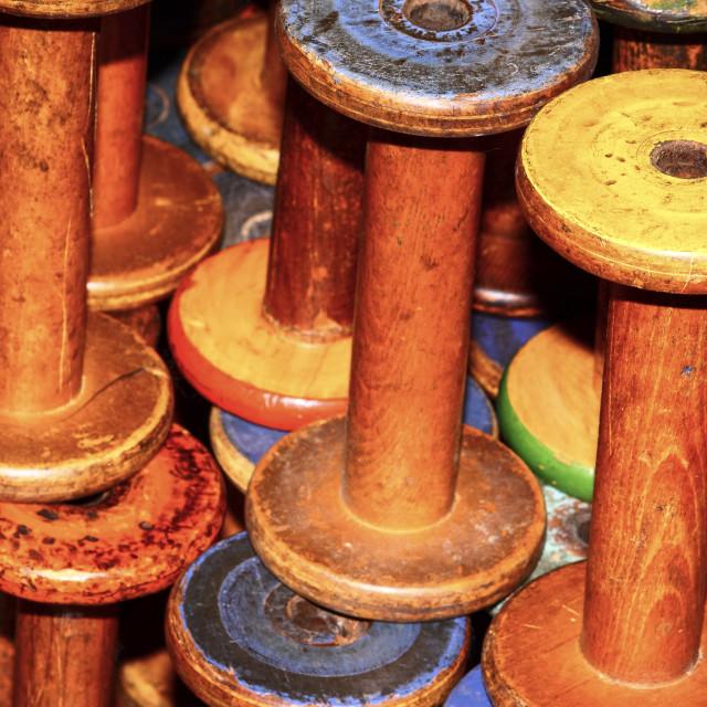 """Old vintage empty weaving loom bobbins"" stock image"