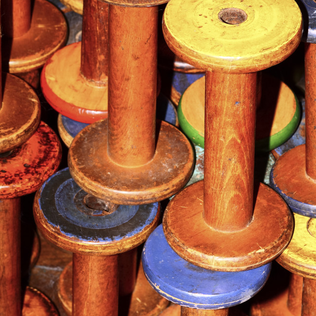"""Old vintage empty weaving loom bobbins"" stock image"