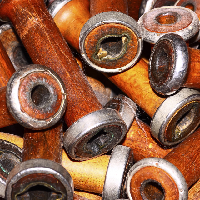 """Empty wooden vintage weaving loom bobbins"" stock image"