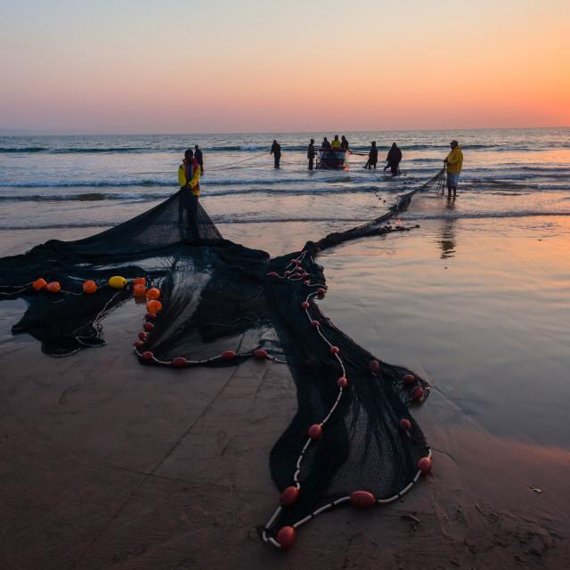 """""""Fishing Netting Boat Oars Beach Ocean Dawn"""" stock image"""