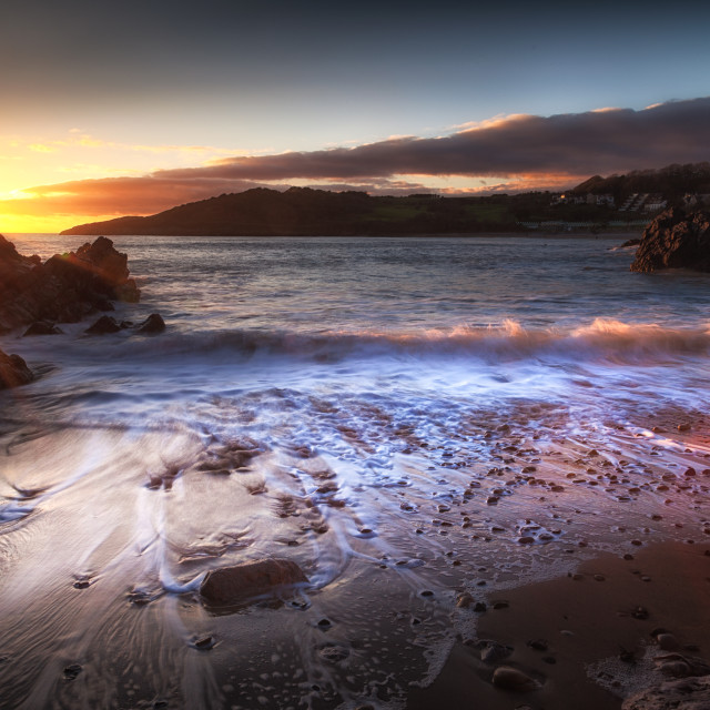 """""""Sunset at Rotherslade Bay"""" stock image"""