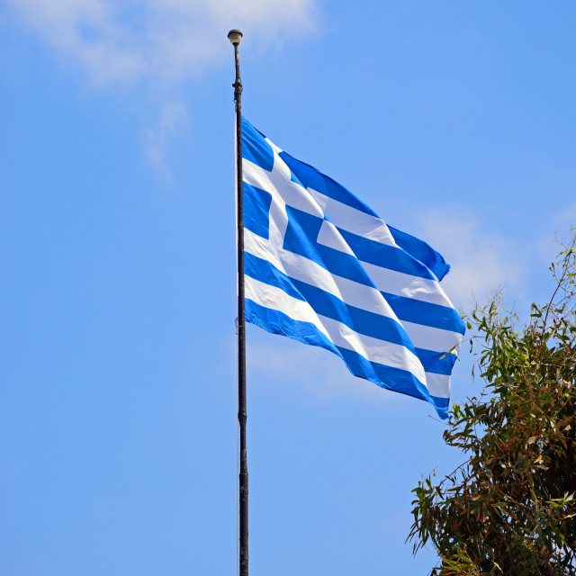 """Greek flag in Malia, Crete"" stock image"