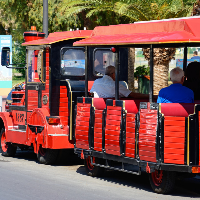 """""""Tourists aboard a red land train along the promenade in Rethymno, Crete"""" stock image"""