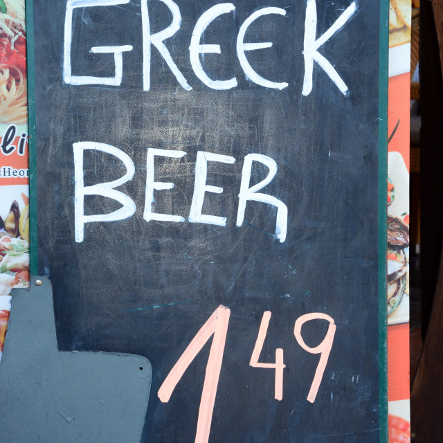 """Greek beer advertised on a chalkboard, Rethymno, Crete"" stock image"