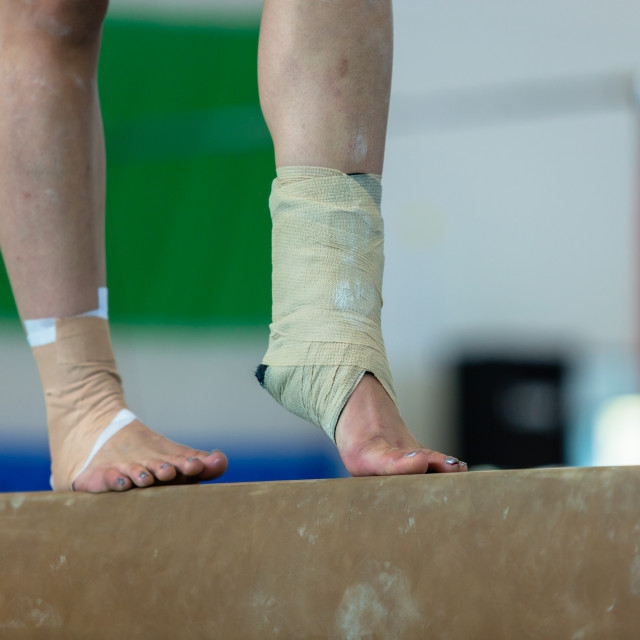 """Gymnast Girl Beam Ankle Srtapped"" stock image"