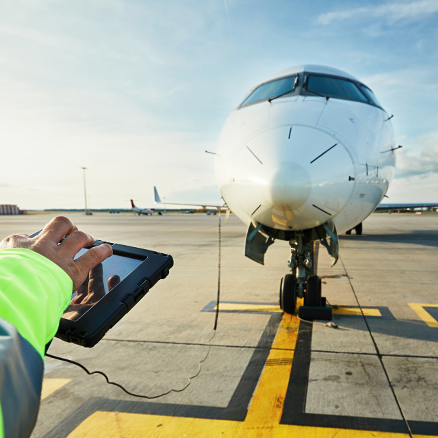 """Preparations of passenger airplane at the airport"" stock image"