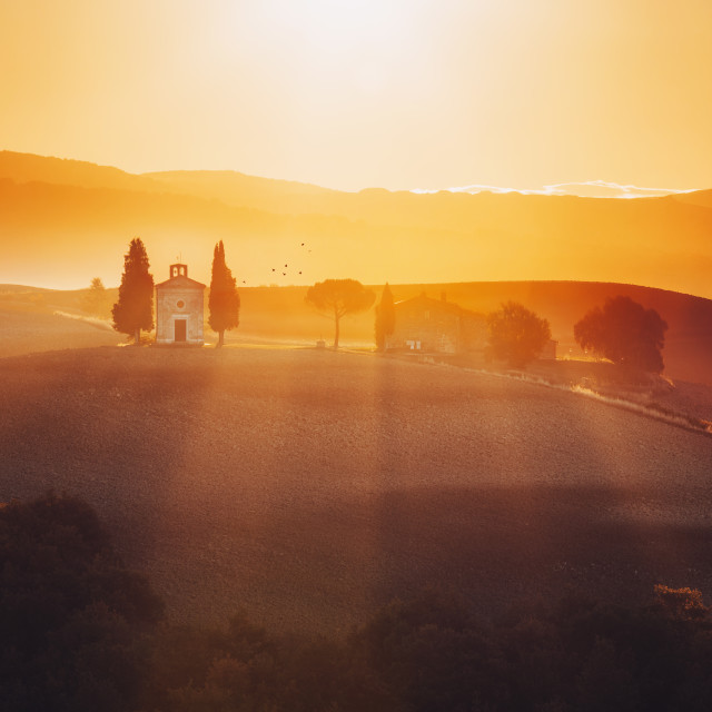 """""""Tuscany landscape at sunrise with a little chapel of Madonna di"""" stock image"""