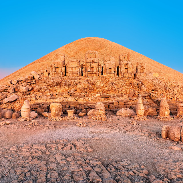 """""""Statues on the summit of Mount Nemrut in Turkey on sunrise"""" stock image"""