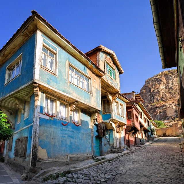 """""""Old traditional ottoman house street with the Karahisar castle in background,..."""" stock image"""
