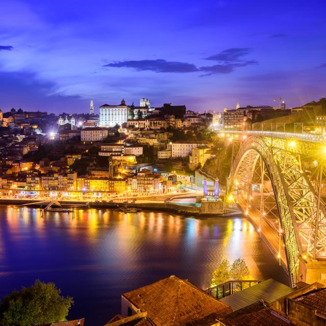 """Ribeira and the Dom Luiz bridge at night, Porto, Portugal"" stock image"