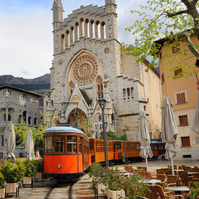 """Old tram in front of the Cathedral of Soller, Mallorca, Spain"" stock image"