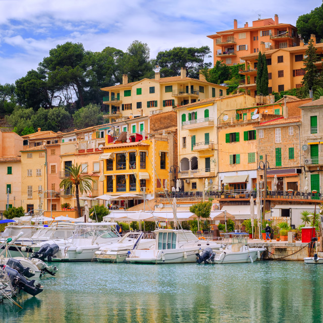 """Motor boats and traditional houses in Puerto Soller, Mallorca, Spain"" stock image"